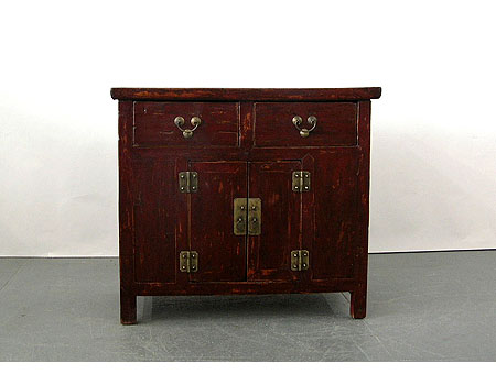 An unusual dark-brown lacquer small country-style table cabinet
